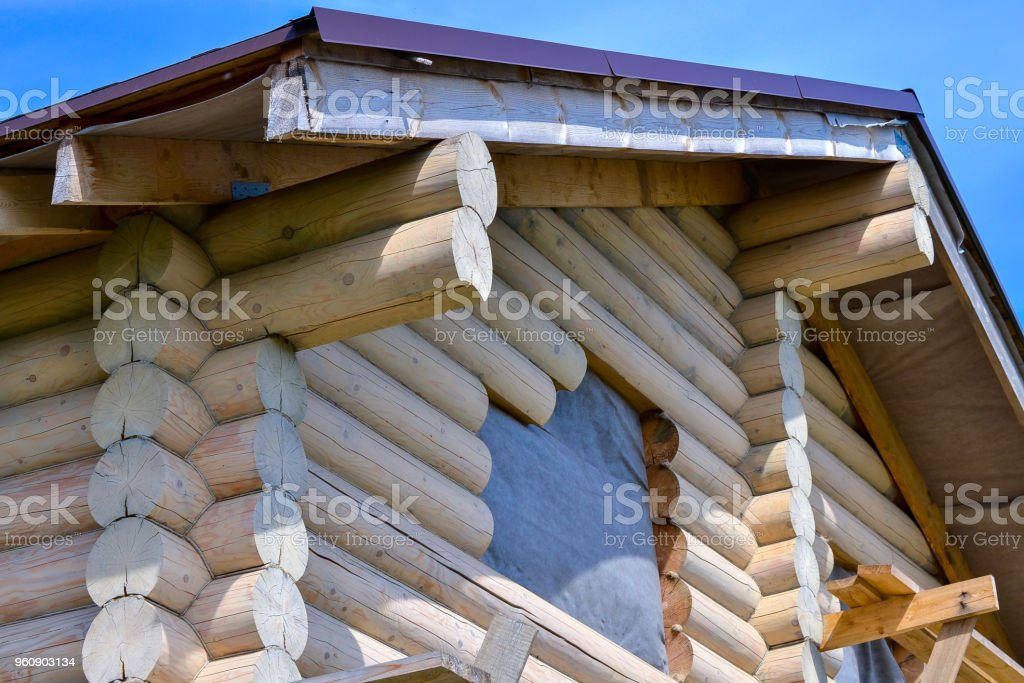 Construction of a wooden house made of logs. Ecological house.