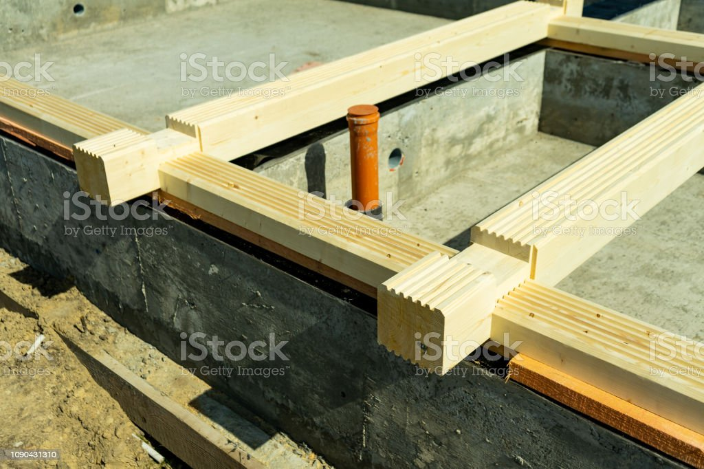 Construction of a wooden house made of profiled laminated veneer...