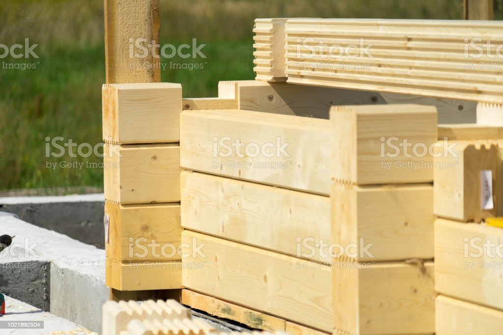 Construction of a wooden house of laminated veneer lumber.