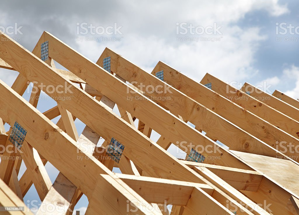 Construction of a wooden roof frame underway royalty-free stock photo