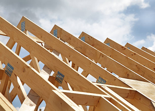 Construction of a wooden roof frame underway stock photo
