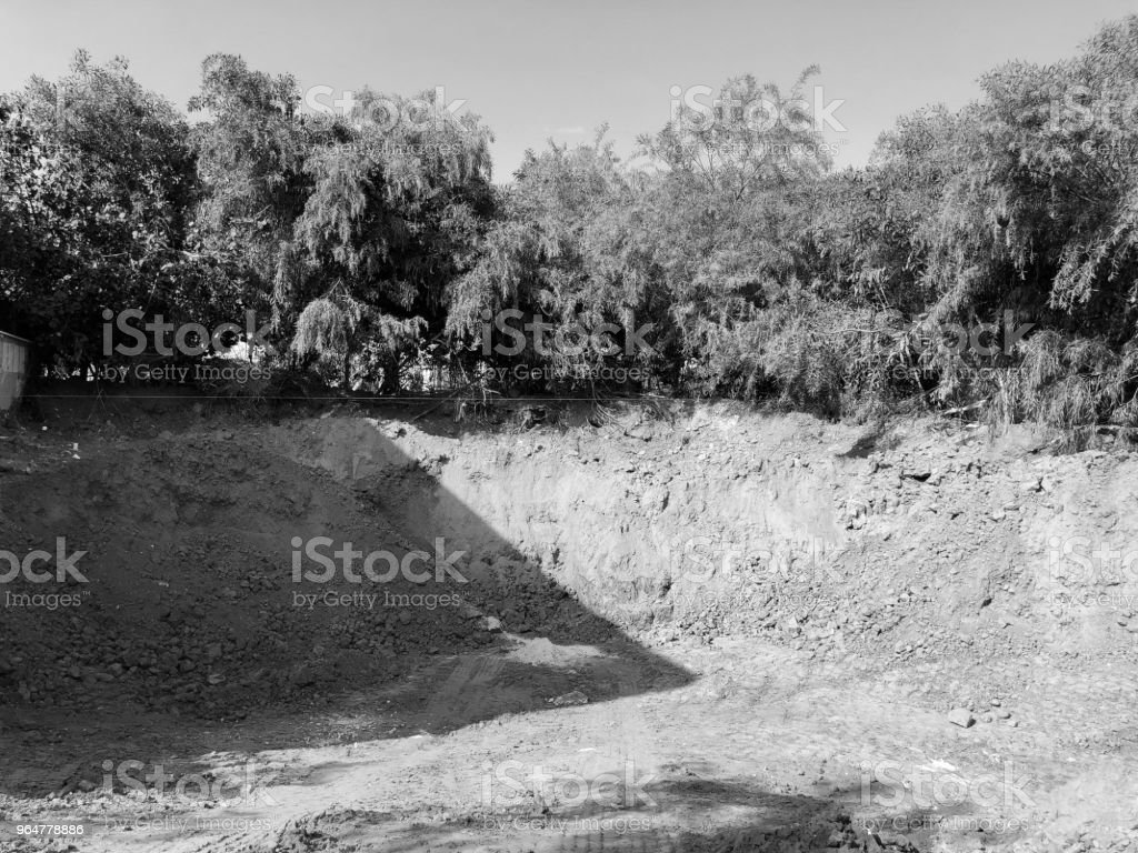 Construction of an industrial building deep foundation pit royalty-free stock photo