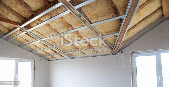 istock Construction of ceiling insulation 576604916