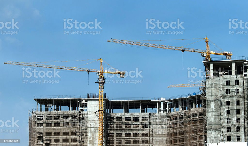 Construction of concrete with cranes royalty-free stock photo