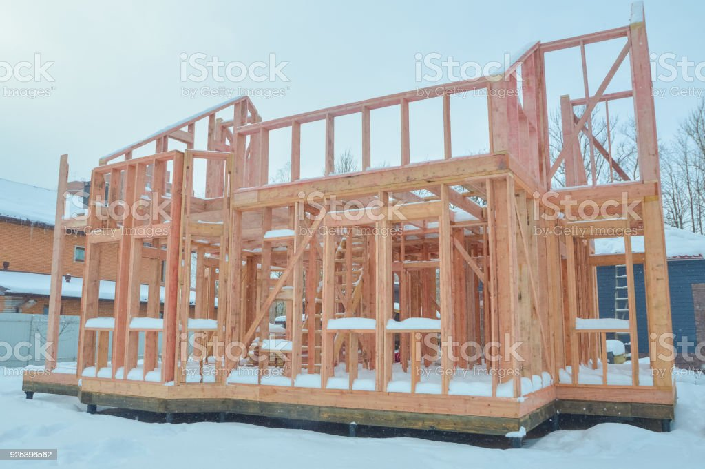 Construction Of Frame Wooden House In Winter Stock Photo