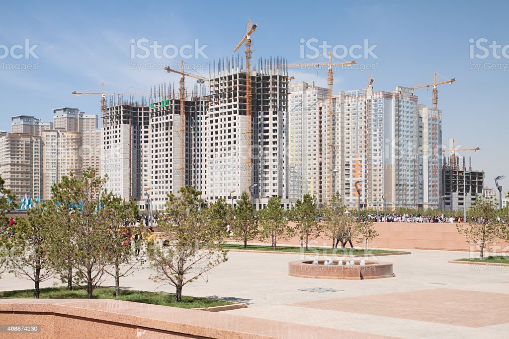 Construction of modern high-rise apartment complexes stock photo