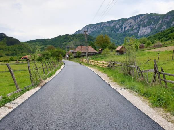 Construction of new asphalt road in Salciua stock photo