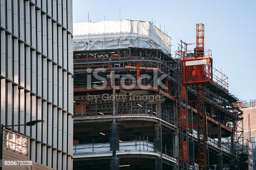 istock Construction of new building. Scissor lift going up 635673228