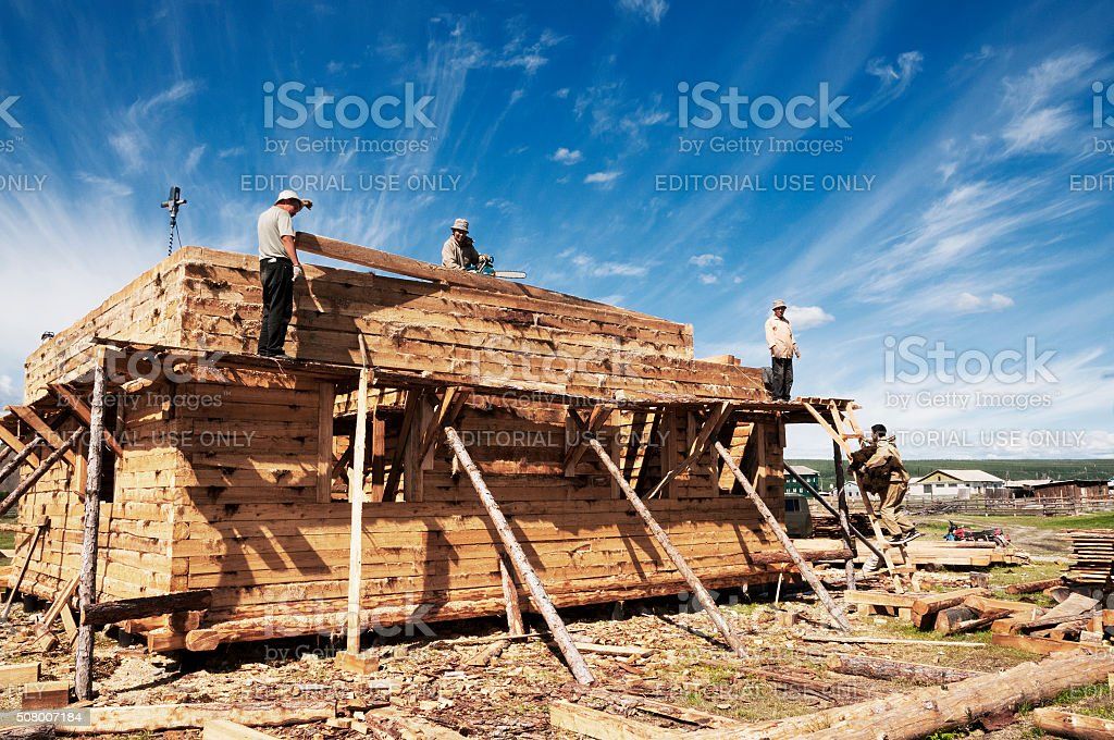 Construction of private houses of wood larch in Tomtor stock photo