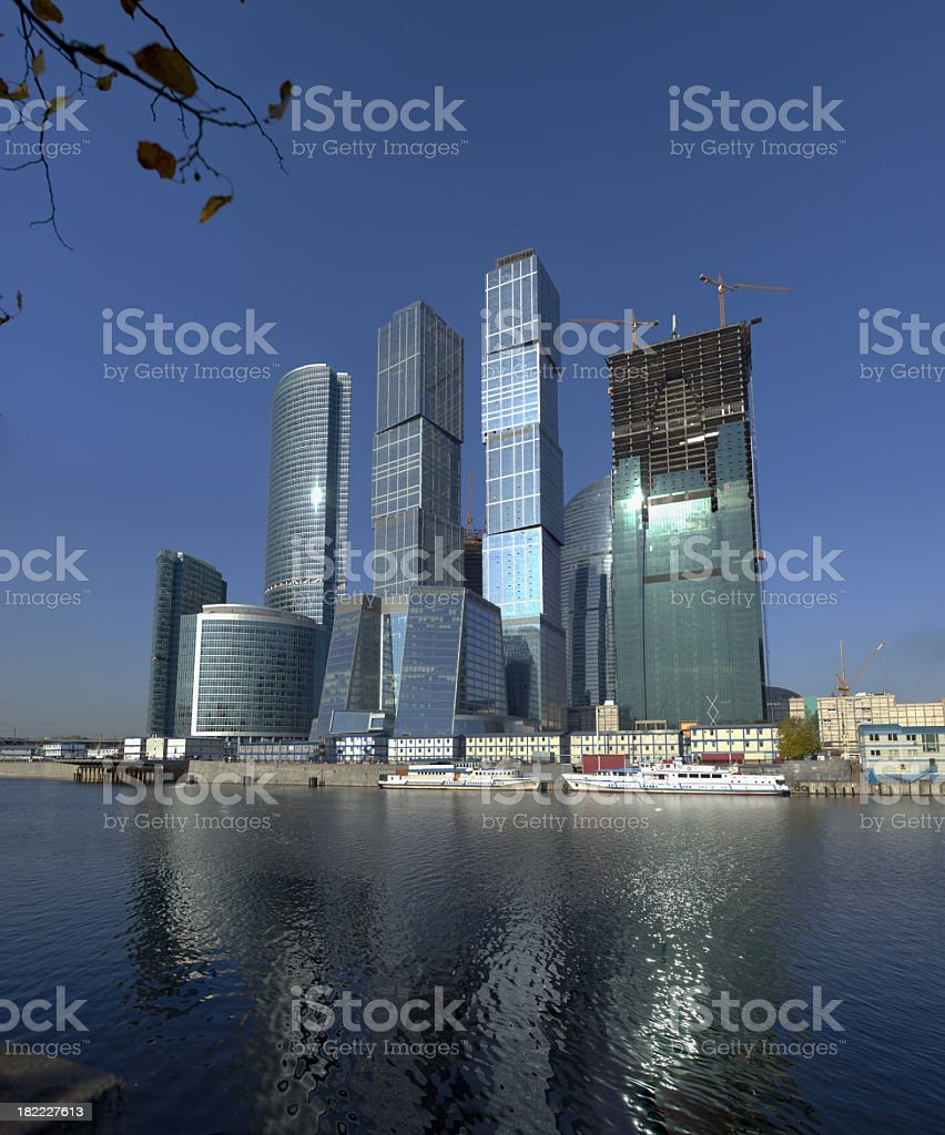 Construction of skyscrapers in downtown on the picturesque quay. royalty-free stock photo