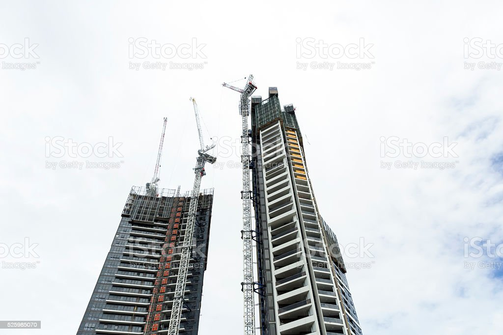 Construction of skyscrapers with tower cranes, Australia, copy space stock photo