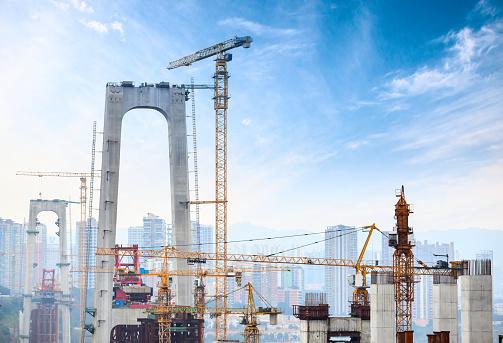 Construction of tall concrete pylon of bridge using tower crane