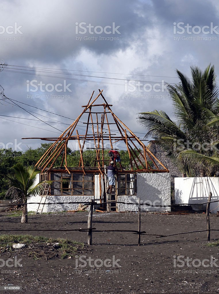 Construction of thatched roof building stock photo