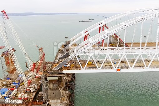 istock Construction of the bridge. Engineering facilities for the const 1081087058