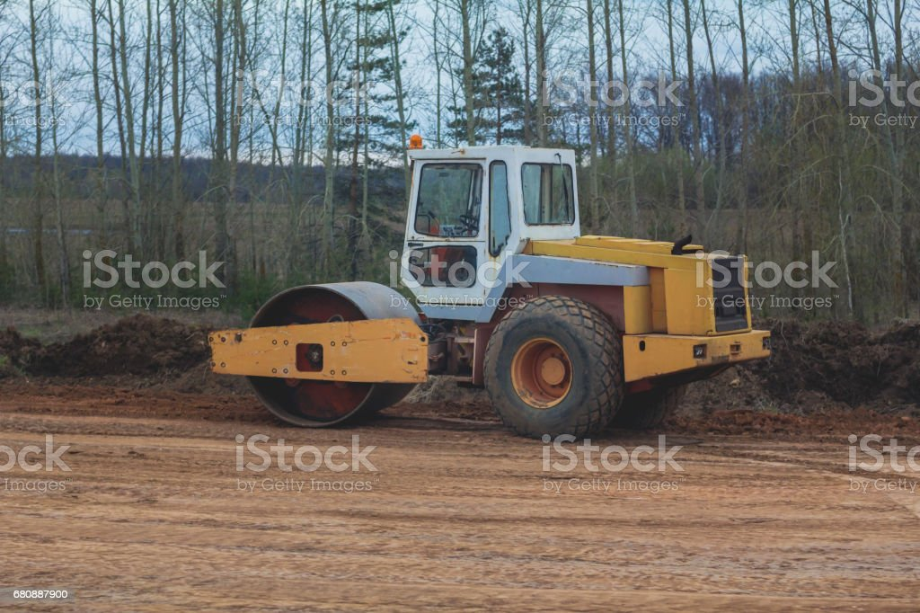 Construction of the highway - road rollers - asphalt pavement works royalty-free stock photo