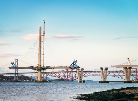 Construction in progress of the new bridge over the Firth of Forth, between Fife and the Lothians.