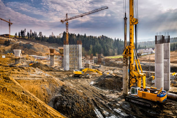 construction of the viaduct on the new s7 highway, luban, poland - crane construction machinery stock pictures, royalty-free photos & images
