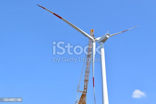 istock Construction of windfarm in eastern Europe 1004862180
