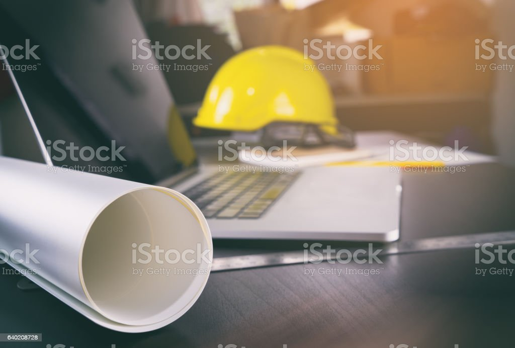 construction office desk with computer and paper works stock photo