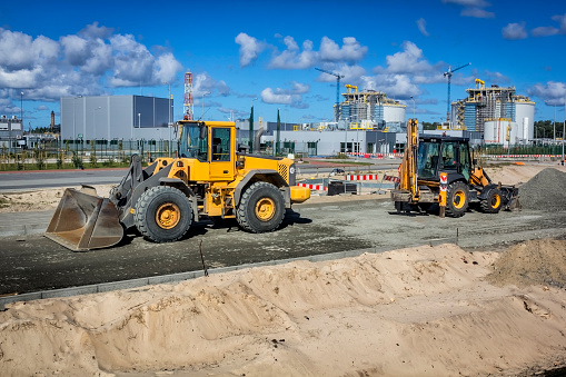 Earth mover working in a new road construction to the liquid natural gas storage tanks, Swinoujscie, Poland