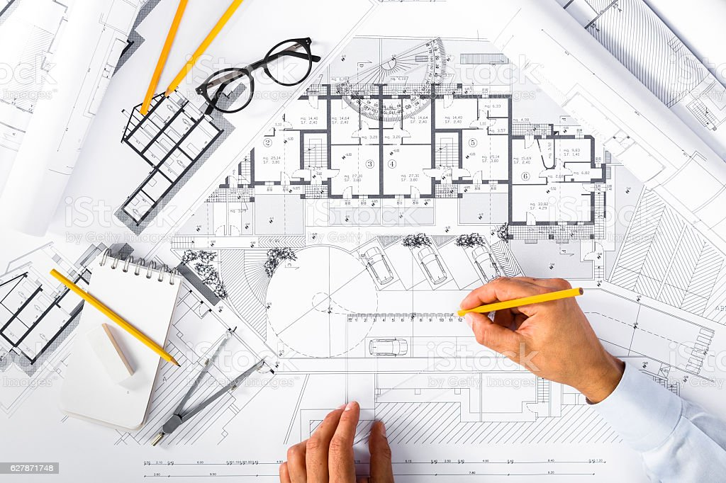 Construction plans and male hands drawing on blueprints stock photo construction plans and male hands drawing on blueprints royalty free stock photo malvernweather Choice Image