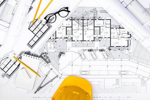istock Construction plans with Tablet, drawing and working Tools on blu 637563348