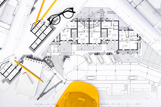 Construction plans with Tablet, drawing and working Tools on blu - foto de stock