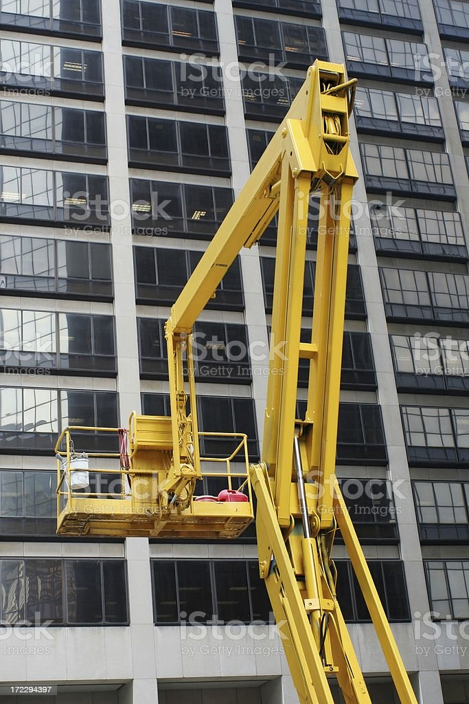 Construction platform in front of highrise royalty-free stock photo