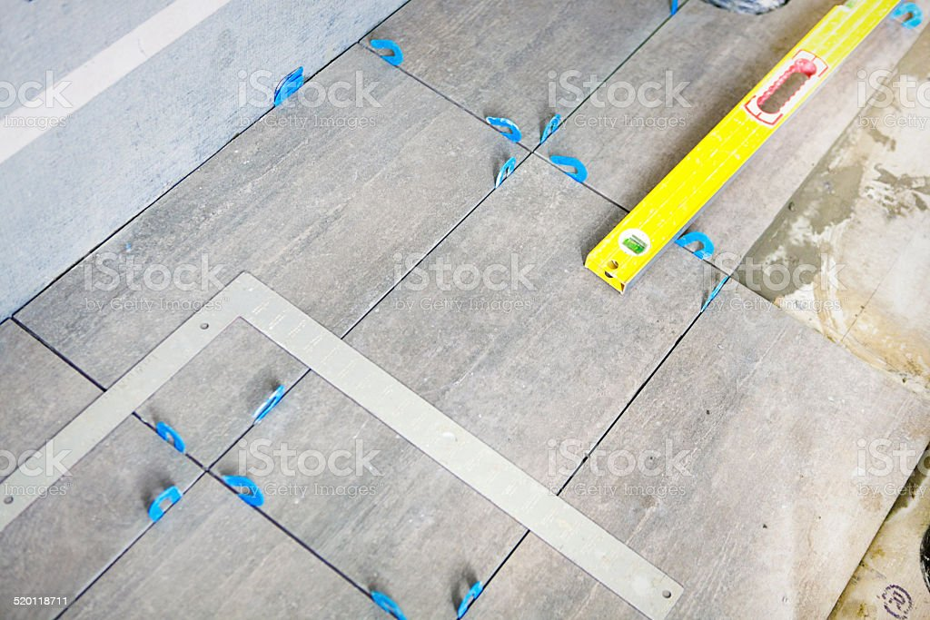 Construction Remodeling Tiling Floor with Ceramic Tiles stock photo