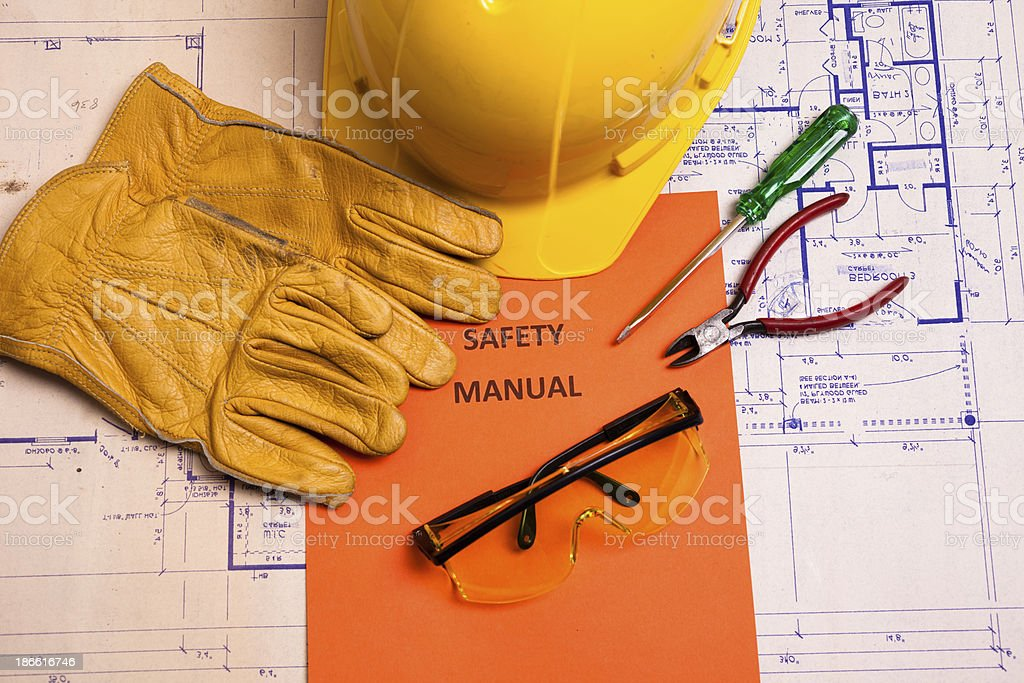 Construction:  Safety manual and workman's tools on floorplans. royalty-free stock photo