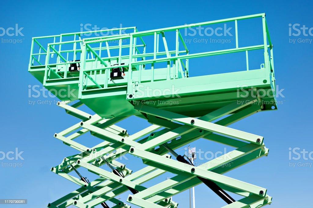 Construction scissor lifts - Foto stock royalty-free di Affari