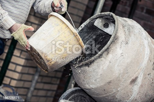 istock Construction site:  Adding water to cement 166725171