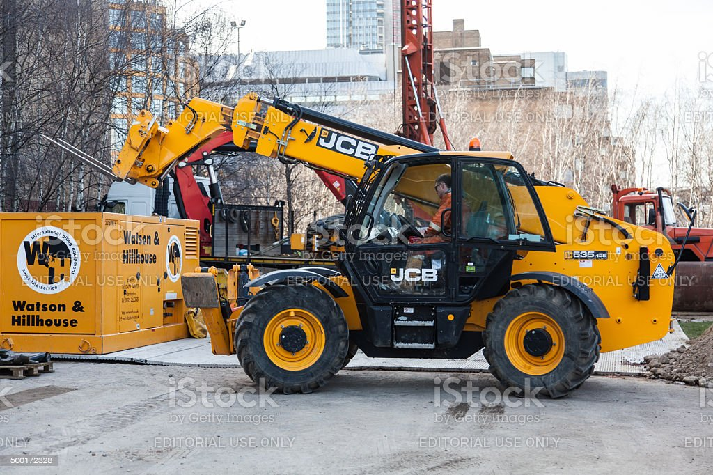 Construction site and a yellow JCB Forklift stock photo