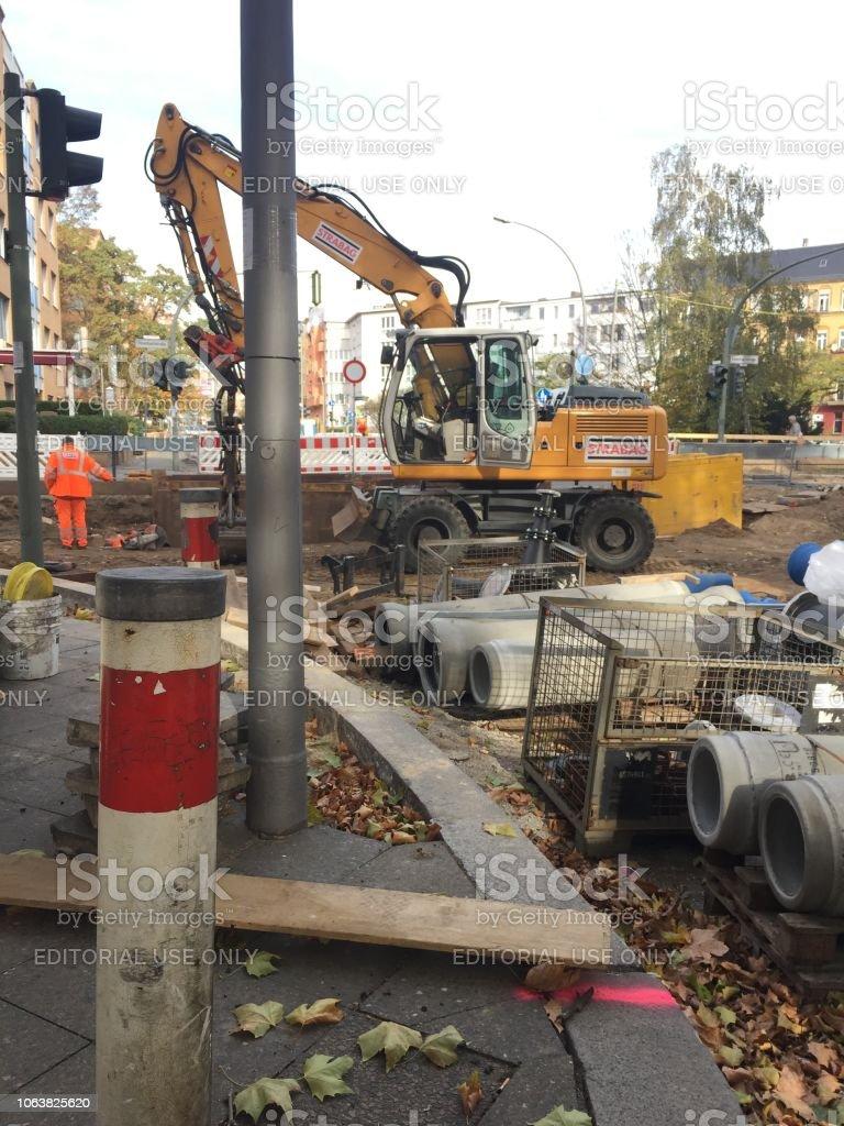 Strabag hydraulic excavator on construction site. STRABAG SE is an...
