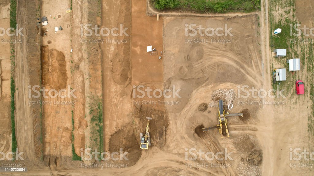Construction site and machinery, archaeological site - aerial view