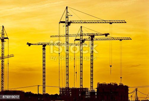 Construction site at dusk evening yellow light, crane