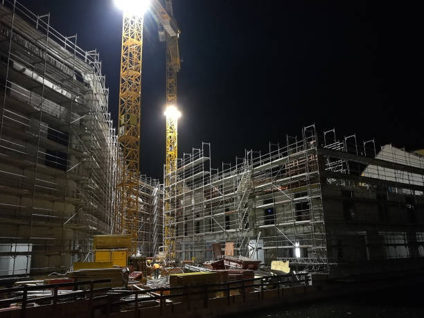 construction site at night with crane stock photo