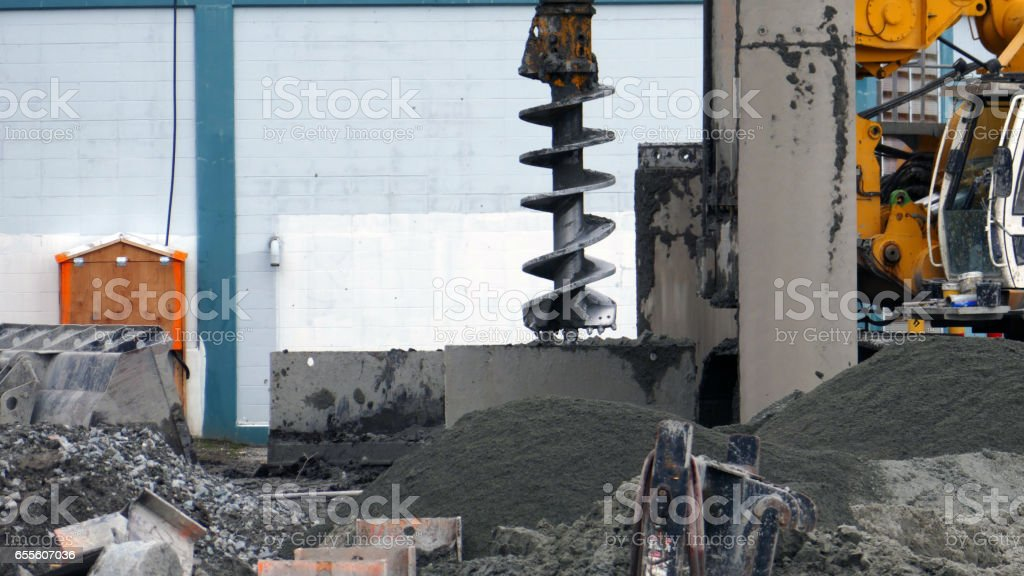 Construction site auger drill rig stock photo