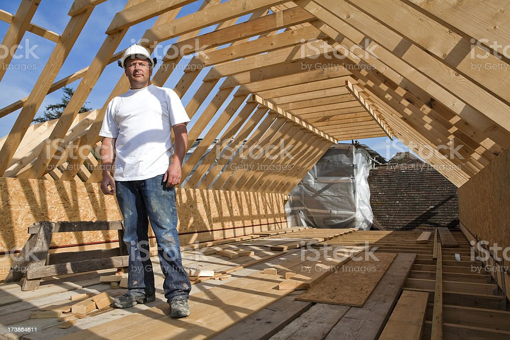 Construction Site Builder Under Timber Frame Roof royalty-free stock photo
