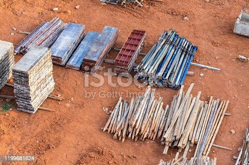 Stack of building material such as wood, metal sheet or concrete are prepared in construction site.