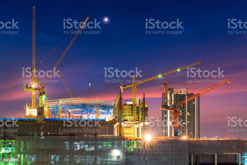 Construction site busy operate in beginning of building new complex infrastructure project at twilight time. stock photo