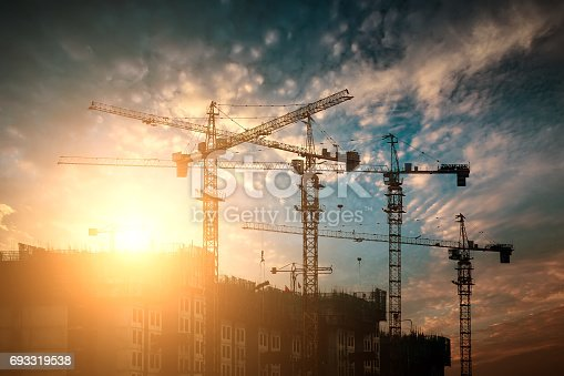 Construction site crane at sunset