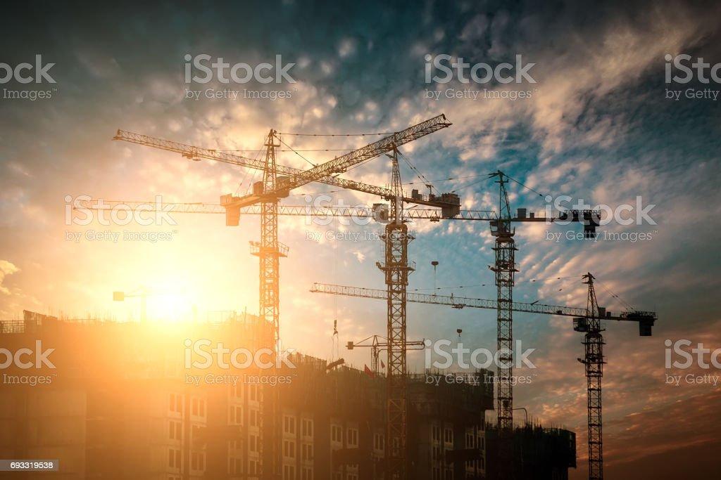 Construction site crane at sunset stock photo