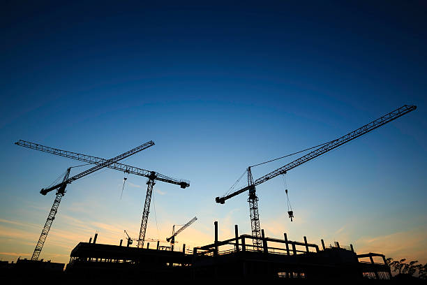 construction site - cranes - crane construction machinery stock pictures, royalty-free photos & images