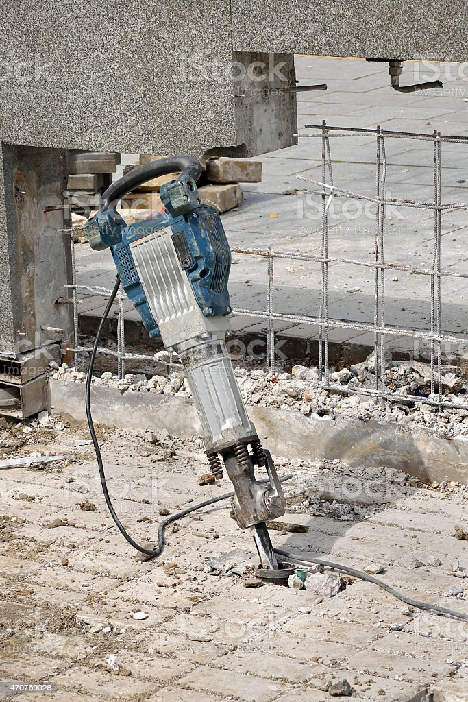 Construction site, demolishing with electric plugger stock photo