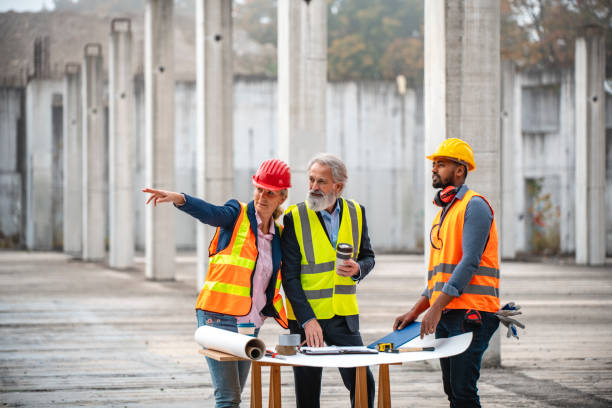 Construction Site Developers Working on Plans stock photo