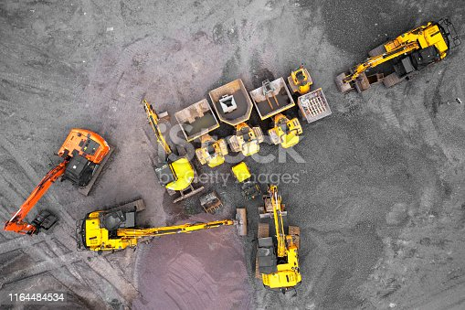 Construction site diggers yellow and orange aerial view from above uk