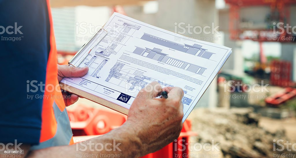Construction Site Engineer Working Blueprint stock photo