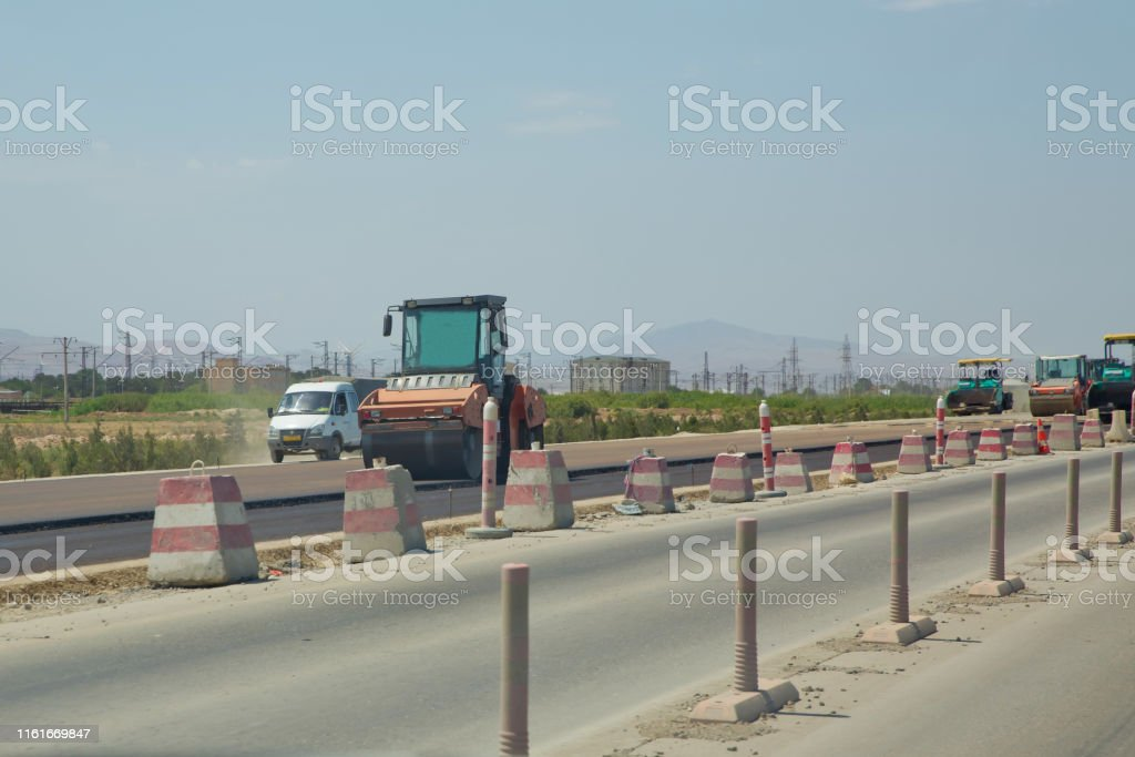Road works in the city. Working on special equipment cut off the old...