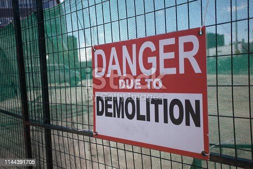 97709303 istock photo Construction Site Fenced Area Danger Due to Demolition 1144391705